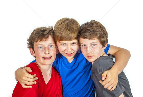 Trzy szczęśliwy radosny znajomych cieszyć się życia Zdjęcia stock © meinzahn