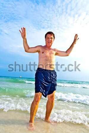 man enjoys the beautiful sandy beach Stock photo © meinzahn