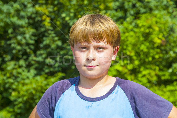 boy with sweating face after sport looks confident Stock photo © meinzahn