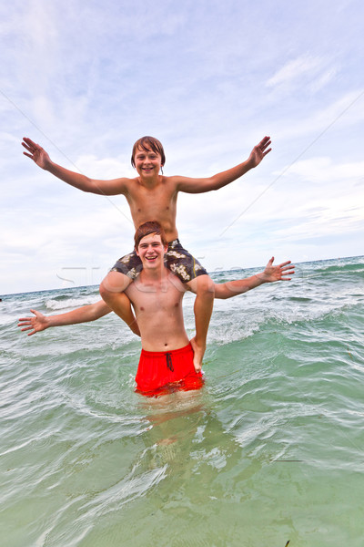 brothers have fun in the beautiful clear sea Stock photo © meinzahn