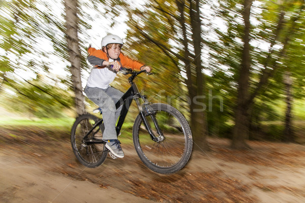 boy jumping over a ramp with his dirtbike Stock photo © meinzahn