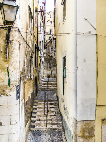 cobble stone street in old town of lisbon Stock photo © meinzahn