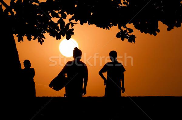 Mooie zonsondergang twee indonesisch lokaal vrouwen Stockfoto © meinzahn