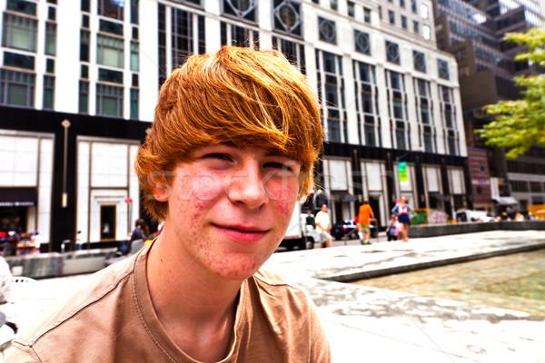 Vidám fiú serdülőkor savanyúság arc mosoly szemek Stock fotó © meinzahn