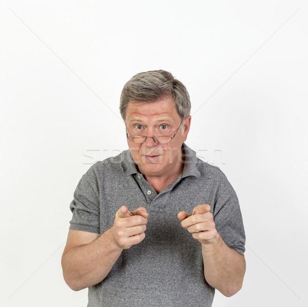Mosolyog érett férfi szürke pólóing portré kéz Stock fotó © meinzahn