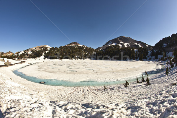 crater lake with snow on Mount Lassen in the national park Stock photo © meinzahn