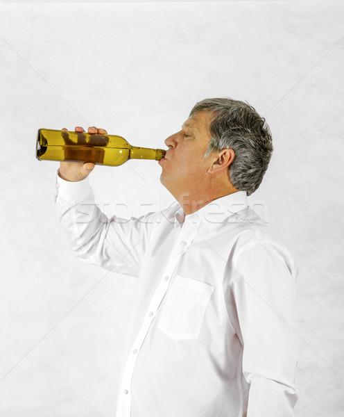 Iszik férfi italok bor ki üveg Stock fotó © meinzahn