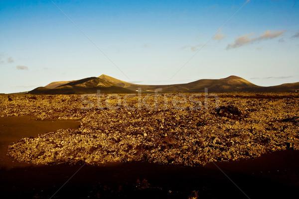 volcano landscape at sunset, national parc of Timanfaya Stock photo © meinzahn