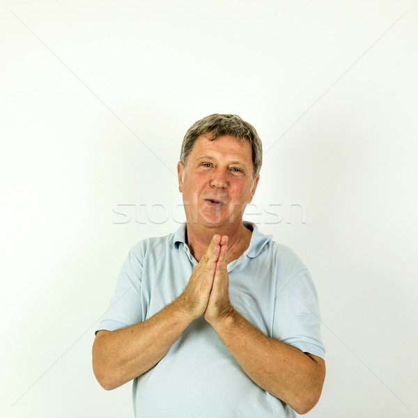 handsome smiling man in blue leisure polo shirt  Stock photo © meinzahn