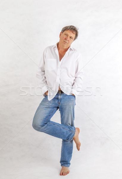 Homem maduro em pé para cima branco mão cara Foto stock © meinzahn