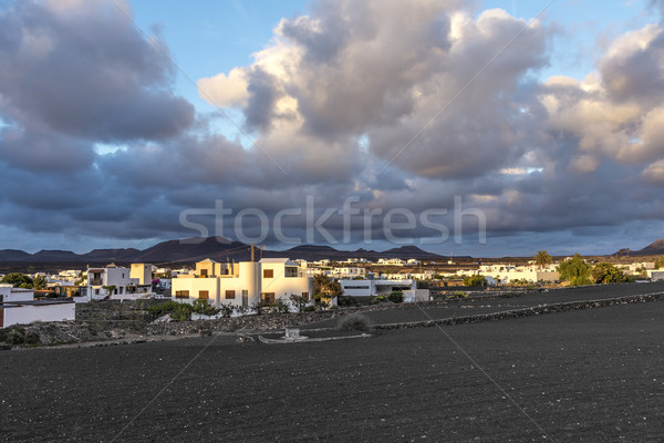 View on traditional whitewashed village with volcanos on the bac Stock photo © meinzahn