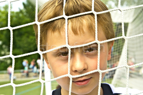 young boy plays soccer and enjoys it Stock photo © meinzahn
