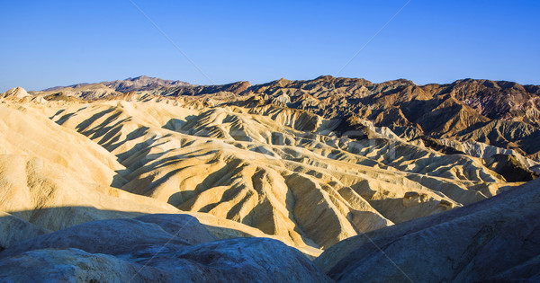 Picturesque soft waves from multi-coloured sandstone. Death vall Stock photo © meinzahn