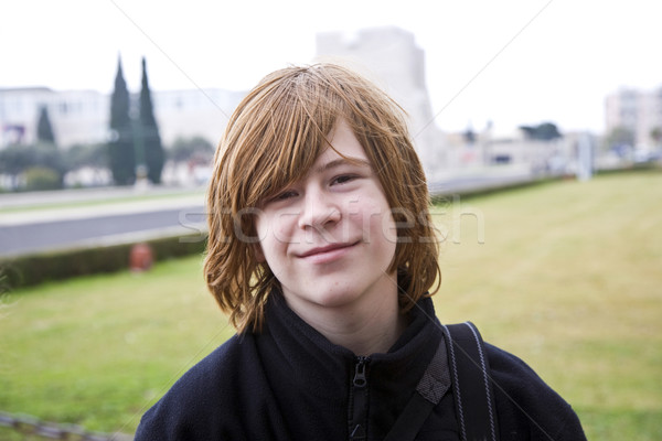 young boy with red hair is smiling and looking happy Stock photo © meinzahn