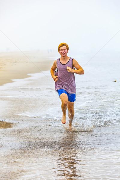 Atractivo nino correr playa manana agua Foto stock © meinzahn
