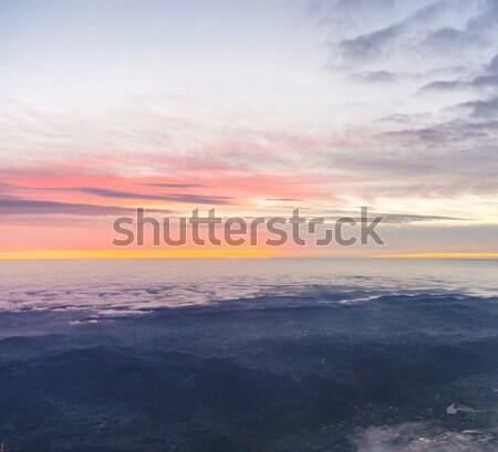 Spektakularny Świt chmury miasta tle pomarańczowy Zdjęcia stock © meinzahn