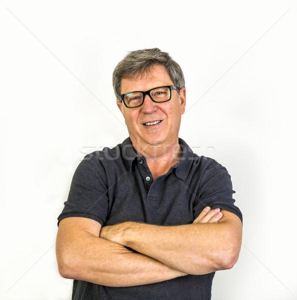 Knappe man portret gelukkig naar studio mode Stockfoto © meinzahn