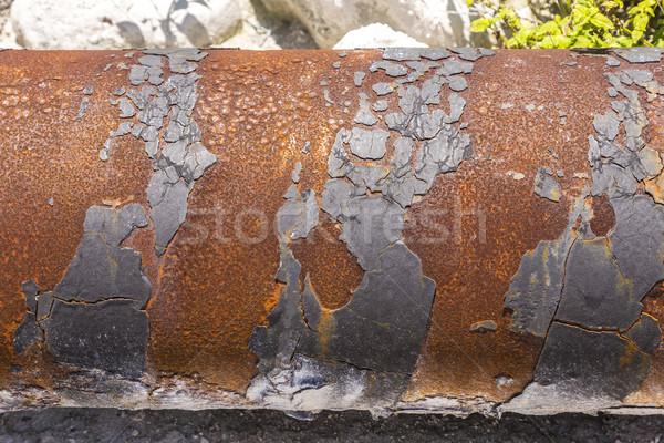 öreg rozsdás csövek tengerpart víz nap Stock fotó © meinzahn