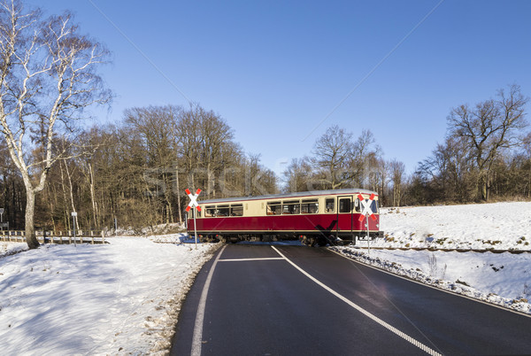 train of the Selketal line crosses a street in winter landscape Stock photo © meinzahn