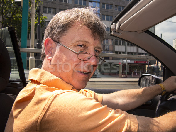 man driving his cabrio at a sunny day Stock photo © meinzahn