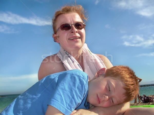 cute boy loves sleeping in his mothers arms Stock photo © meinzahn