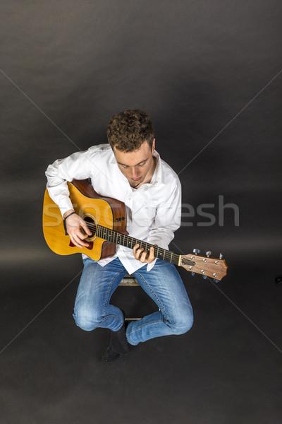 Adolescente guitarrista cadeira ocidental guitarra música Foto stock © meinzahn
