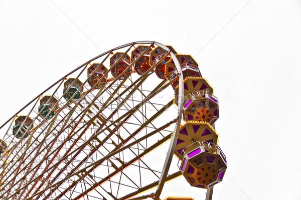 big wheel in motion with dark clouds Stock photo © meinzahn