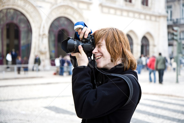 young boy likes fotography even when his arm is in blast due to  Stock photo © meinzahn