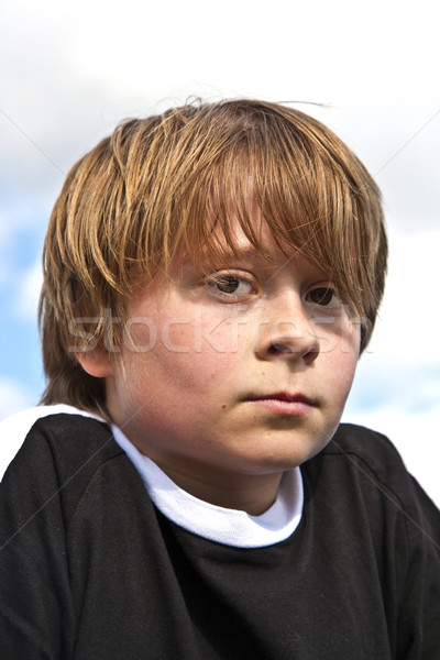 young boy looking seriously  Stock photo © meinzahn