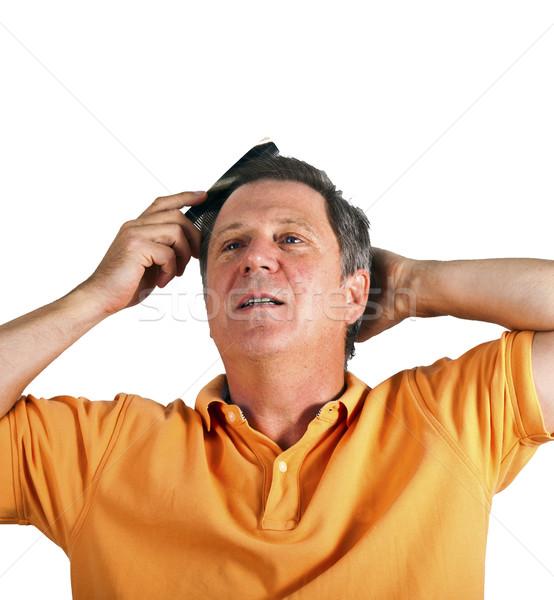 attractive man combing his hair Stock photo © meinzahn