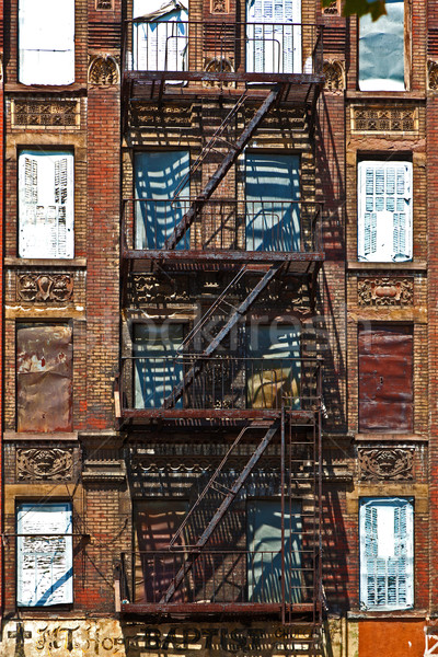 fire ladder at old houses downtown in New York Stock photo © meinzahn