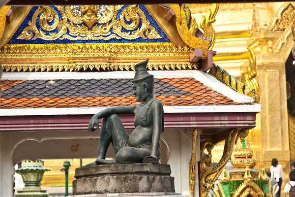 sitting man on a stone capital in the Grand Palace, Bangkok Stock photo © meinzahn