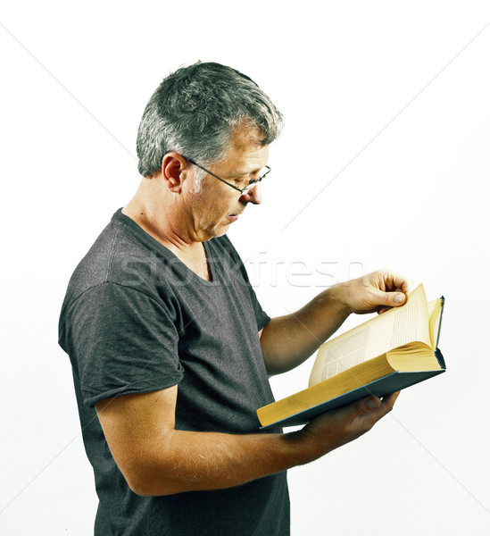 man with glasses reading in a book Stock photo © meinzahn