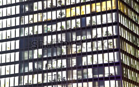 Stock photo: facade of office building by night