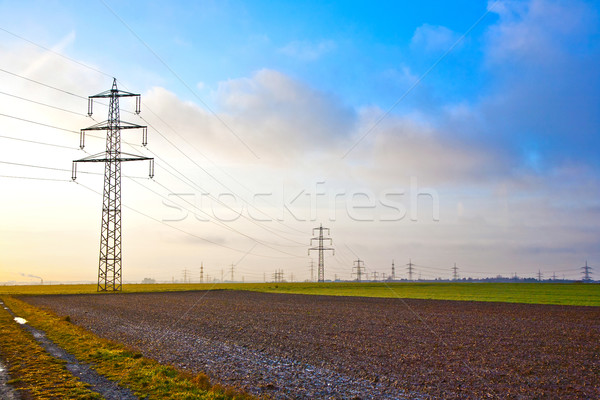 electrical tower in landscape with dark clouds Stock photo © meinzahn