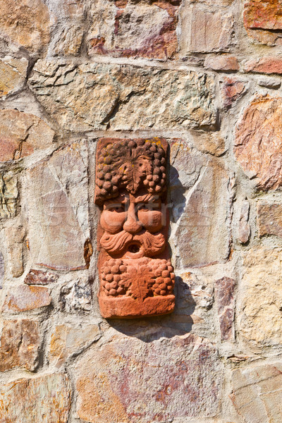 old medieval stone wall with face of baccus, the god of winery Stock photo © meinzahn