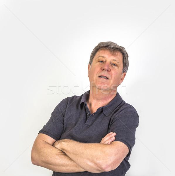 Bonito arrogante homem retrato olhando estúdio Foto stock © meinzahn