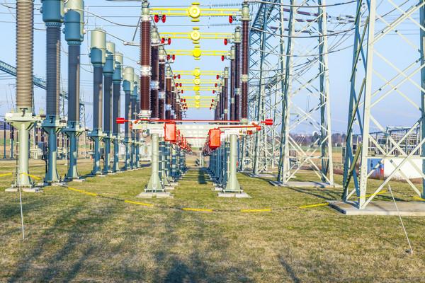 Elektromos feszültség torony vidéki táj kék ég transzformátor állomás Stock fotó © meinzahn