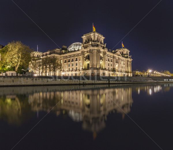 The german Reichstag by night with reflection in river spree  Stock photo © meinzahn