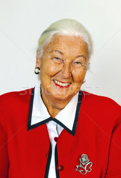Portré mosolyog vonzó idős nő portré nő Stock fotó © meinzahn