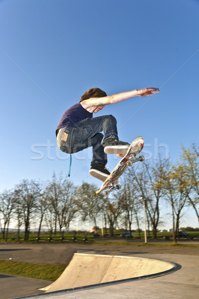 boy going airborne with the skate board Stock photo © meinzahn