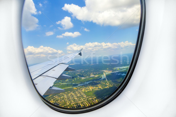 lookout of aircraft window to landscape while landing Stock photo © meinzahn