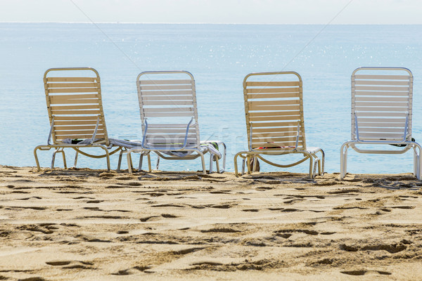 A row of three beach chairs overlooking the sea view  Stock photo © meinzahn