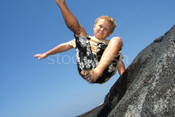 boy has fun jumping in the dunes of the beachin the ocean Stock photo © meinzahn