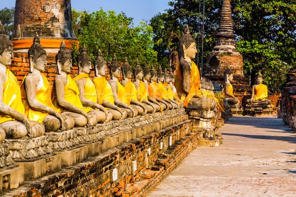 Buddha statues at the temple of Wat Yai Chai Mongkol in Ayutthay Stock photo © meinzahn