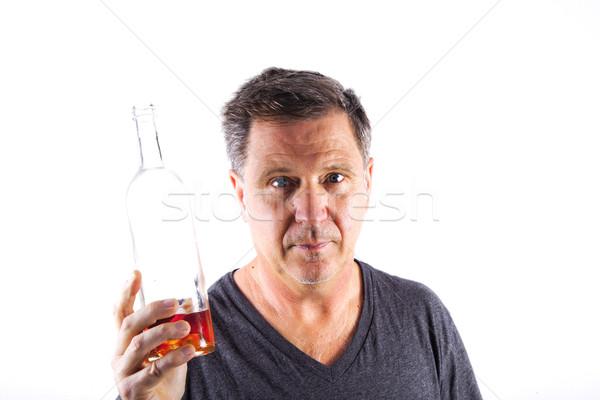 Hombre potable alcohol fuera botella naranja Foto stock © meinzahn