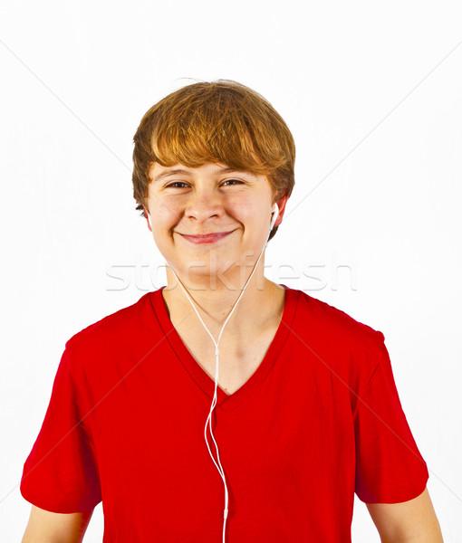 happy boy listening to music via earphone Stock photo © meinzahn