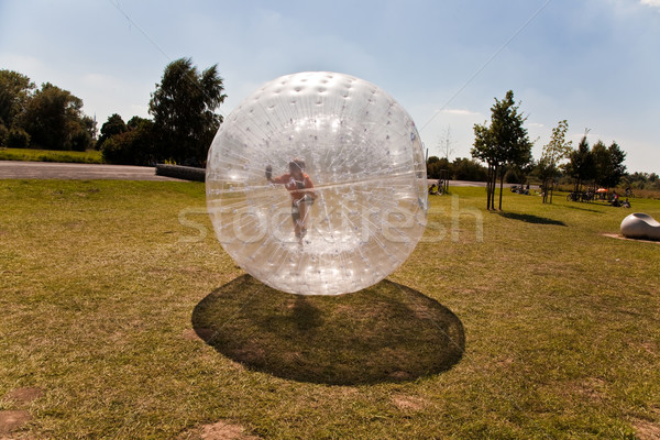 cute child has a lot of fun in the Zorbing Ball Stock photo © meinzahn