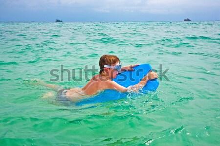 Fiúk szórakozás tenger játszik háton gyönyörű Stock fotó © meinzahn