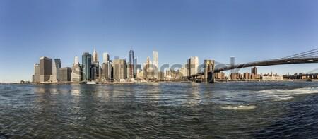 Manhattan sziluett oldal napos idő iroda épület Stock fotó © meinzahn